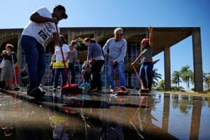 Brasilia, BrazilDemonstrators sweep with their brooms outside the Justice Ministry headquarters during a protest against Brazil's Justice Minister Sergio Moro