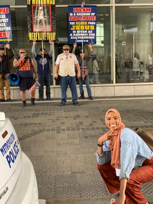 Shamaa Ismaa'eel poses in front of the protesters.