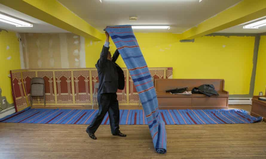 Mohammad Ali Chaudry, the founder and president of the Islamic Society of Basking Ridge, preparing the Bernards Township community centre for Friday prayers.