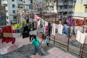 Children play on a rooftop of a residential building in a locked-down part of the Jordon district on 24 January, 2021 in Hong Kong, China.