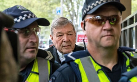 Cardinal George Pell is escorted to court