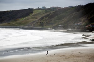 A boy plays on the beach at Scarborough in north Yorkshire