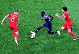 France's Blaise Matuidi attempts to get the better of Belgium's Toby Alderweireld and Axel Witsel.