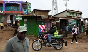A biker passes through the Kawangware slum with an American flag during the visit of the US President Barack Obama to Kenya. An anti-corruption plan to be implemented with US assistance has gone largely unheralded by the Kenyan government.
