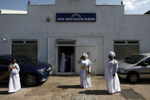 Worshippers leave after Sunday service at the New Jerusalem Parish
