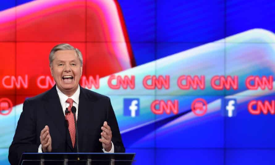 Republican Presidential candidate Lindsey Graham gestures on stage during the under card Republican Presidential debate, hosted by CNN, at The Venetian hotel in Las Vegas, Nevada on December 15, 2015. AFP PHOTO / ROBYN BECKROBYN BECK/AFP/Getty Images