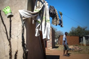 Unemployed miner Zebedias Xerinda, 53, walks by his house in Marikana on 12 August