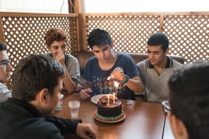 Halil (in blue T-shirt) took his friends to a Turkish cake shop to celebrate
