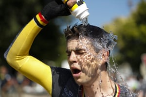 Stage winner Wout Van Aert cools off after crossing the finish line.