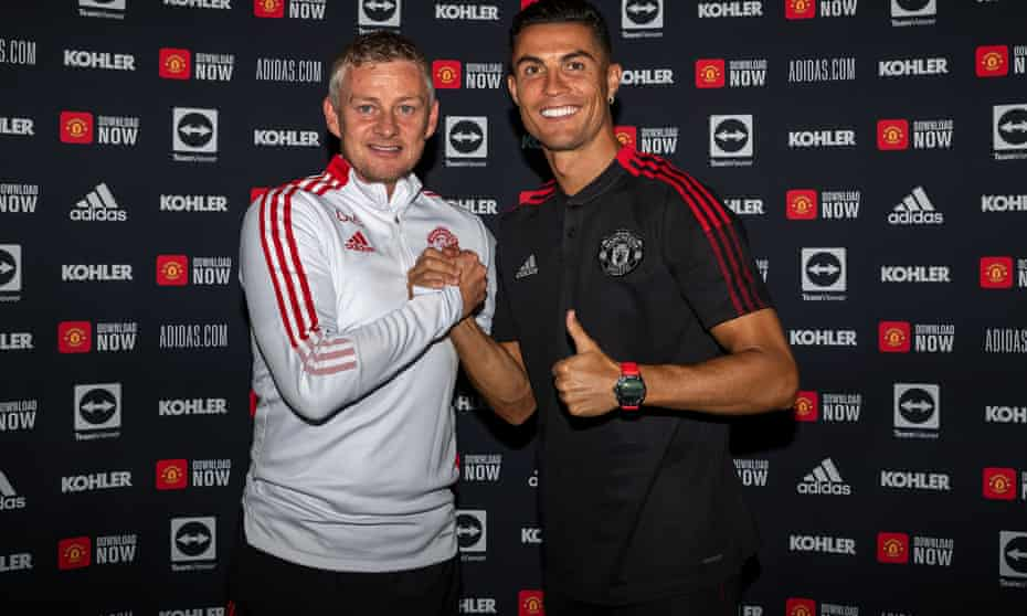 Cristiano Ronaldo with Ole Gunnar Solskjær after signing his contract this week