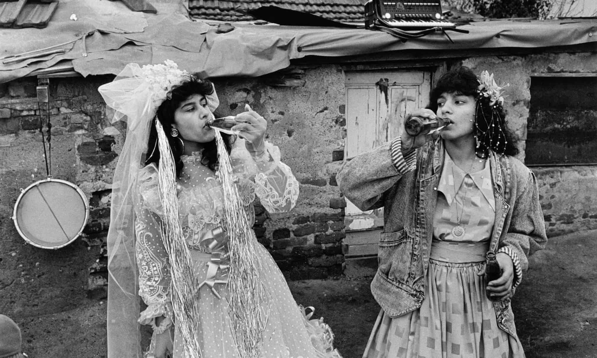 The bride and bridesmaid during a wedding celebrations in Fakulteta, a Gypsy district of Sofia, Bulgaria, 1991See more on this picture - link Sunday 17th big pic piece https://www.theguardian.com/theobserver/series/the-big-picture