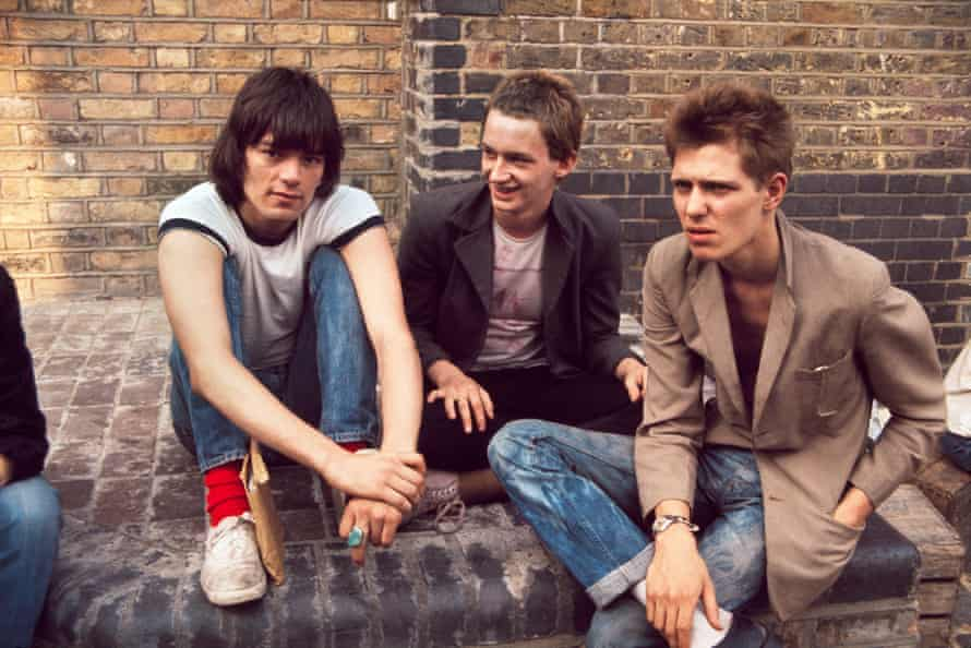Dee Dee Ramone with Keith Levene and Paul Simonon of the Clash, outside the Roundhouse in London, July 1976.