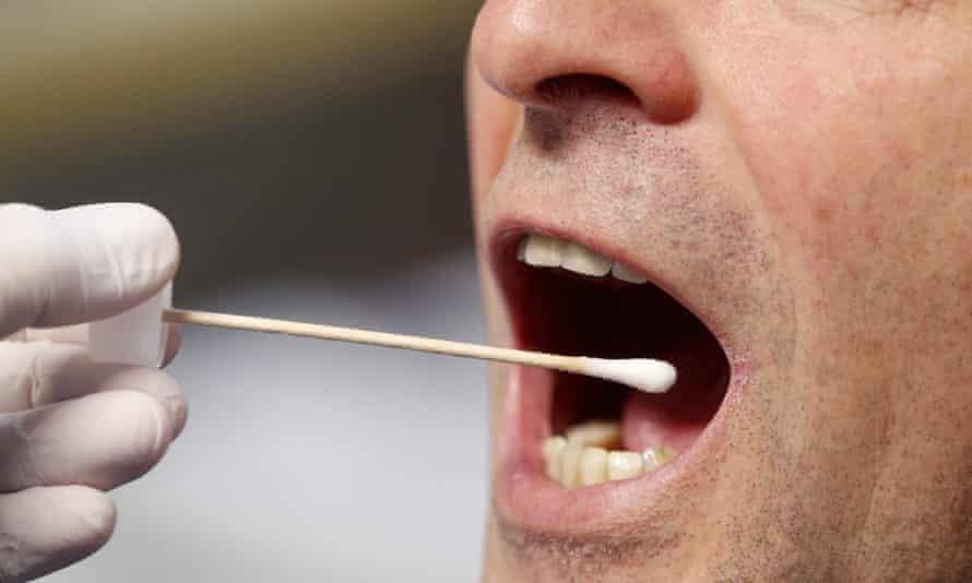 A man takes a saliva test.