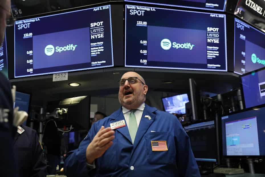 A trader on the floor of the New York Stock Exchange on the morning Spotify began trading shares.