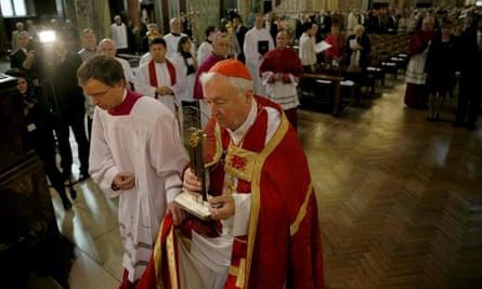 Cardinal Vincent Nichols carries a relic