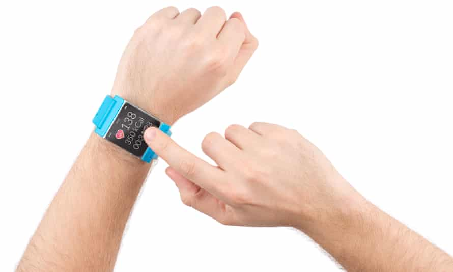Male finger taps on the screen of the smart watch with fitness app