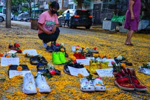 A woman looks at the display for the 'marching shoes strike' in Myaynigone township
