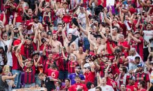 Atlanta fans celebrate their team scoring a goal against the Orlando City Lions in Florida.