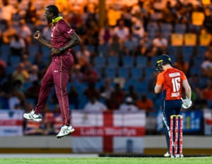Carlos Brathwaite of the West Indies celebrates the dismissal of England captain Eoin Morgan.