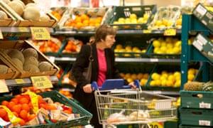 Supermarket shopper in fruit aisle