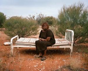 Daisy Ward, an Indigenous elder from Warakurna community, sits for a portrait at a 'sorry place' in Ngaanyatjarraku shire, Western Australia.