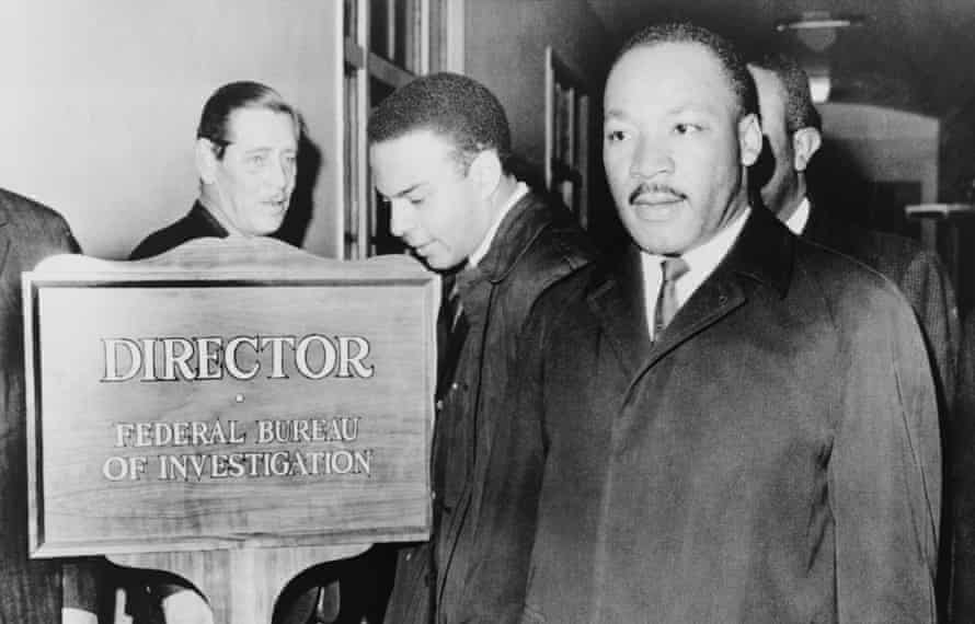 Martin Luther King arrives at FBI headquarters for a meeting with J Edgar Hoover, December 1964.
