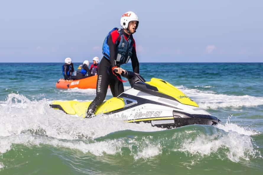 Jago Griffiths rides on a jetski.