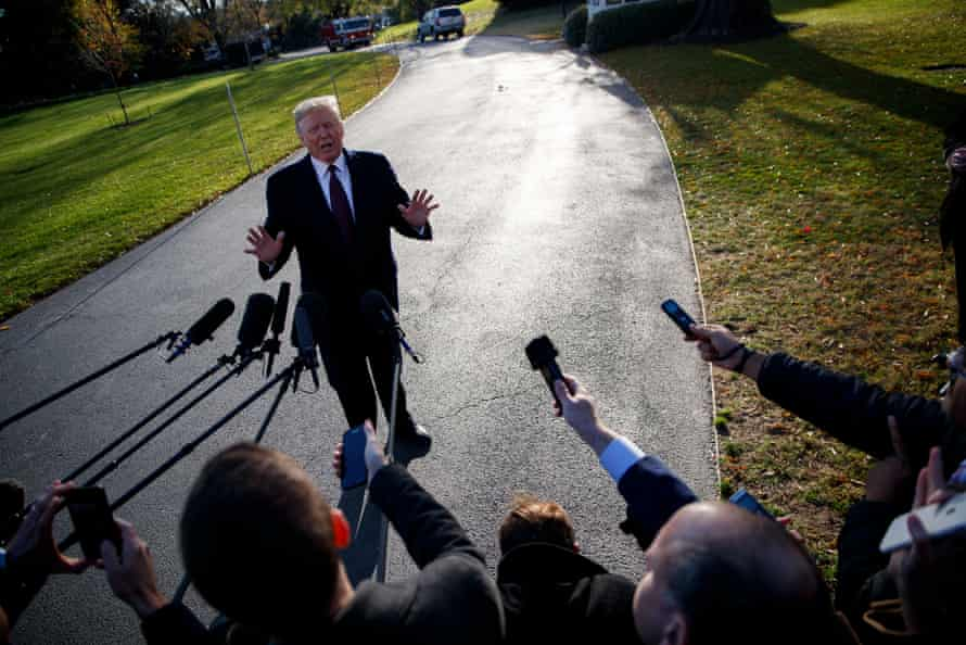 Donald Trump speaks to reporters after submitting written answers to Mueller's investigation.