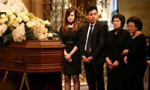 Zilvia Cheng, Alpha Cheng and their mother, Selina, at a funeral service for Curtis Cheng at St Mary's Cathedral in Sydney on Saturday.