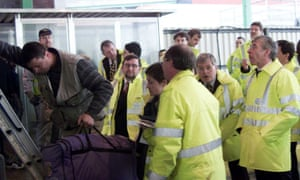 Jack Straw (right) in 2000, then the home secretary, watches as a stowaway is helped down from a lorry at Dover docks.