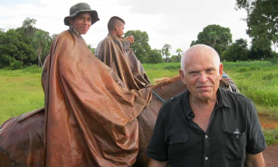 Edward Luttwak with Bolivian cowboys dressed in their natural latex ponchos.