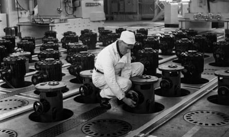 A worker above the reactor core at Calder Hall in Windscale, Cumbria, in 1957.