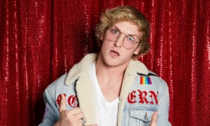 logan paul looking intot the camera in aviator and a a fleeced denim jacket