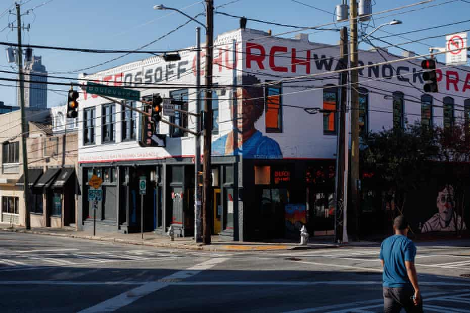 A bar on Edgewood Avenue in Atlanta promotes Democratic Senate candidates Jon Ossoff and Raphael Warnock, with a portrait of Stacey Abrams painted across the corner.