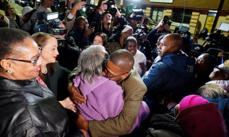 Alfred Chestnut hugs his mother after his release in Baltimore.