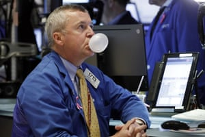 Trader James Lamb watches his screens on the floor of the New York Stock Exchange.