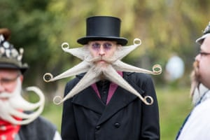 A contestant of the World Beard And Mustache Championships poses for a picture during the opening ceremony of the Championships