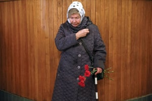 A woman prays during a memorial service in Kiev for victims of the Chernobyl nuclear disaster