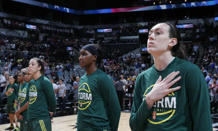 The Seattle Storm stand for the national anthem on 8 July 2016 at the AT&T Center in San Antonio, Texas.