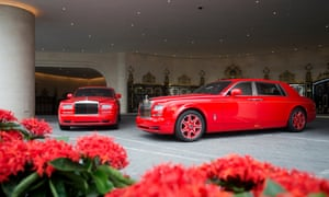 Bespoke red Roll-Royces in the forecourt of The 13 hotel to chaperone guests to and from the property , Macau