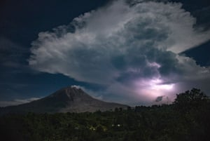 Lightning strikes over the Mount Sinabung volcano in Karo.