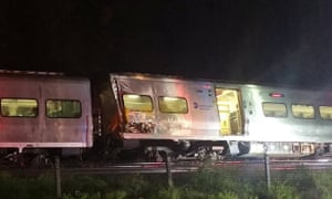 A train sits derailed near the community of New Hyde Park on Long Island in New York.