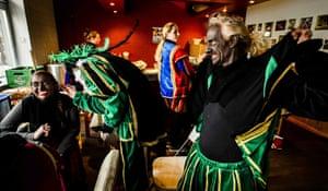 People dress as 'Zwarte Piet' (Black Pete) as they prepare for celebrations of the Dutch Sinterklaas (Saint Nicholas) feast in Nieuwegein