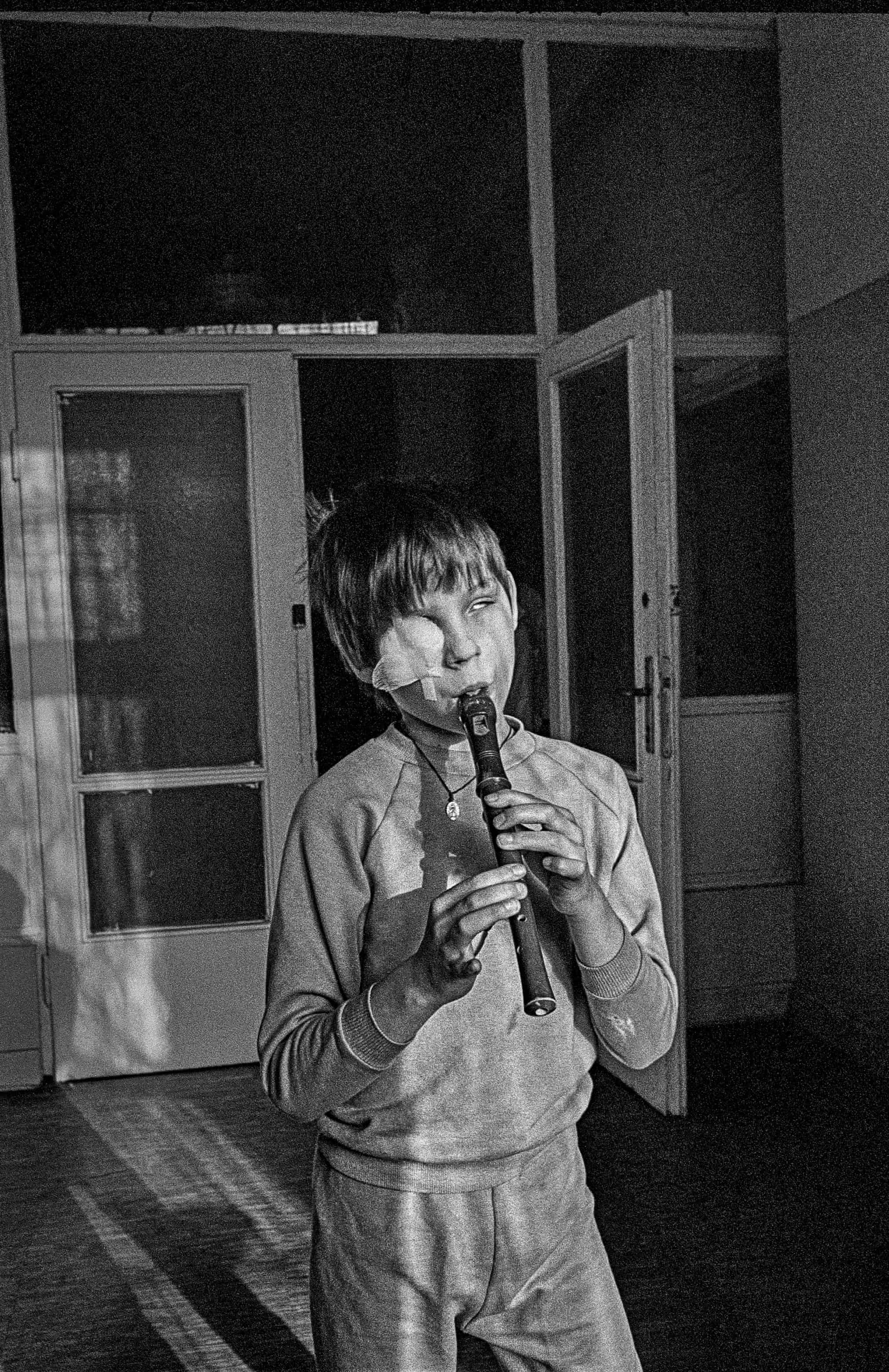 A young patient in the Ophthalmology unit of a hospital. Warsaw, Poland 1986