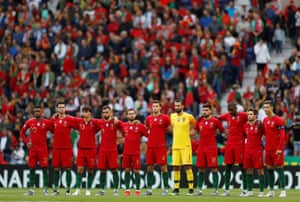 Portugal players during the minute's silence in memory of former UEFA president Lennart Johansson.