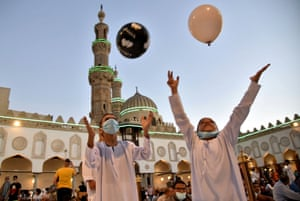 Kids play with balloons after Eid al-Adha prayer inside Al-Azhar Mosque in Cairo, Egypt