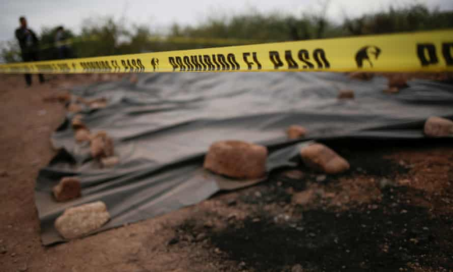 A police cordon is seen at the crime scene where members of the Miller-Lebaron family were killed near Bavispe, Sonora state, Mexico.