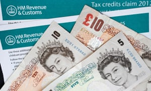 HMRC working tax credit claim form with banknotes