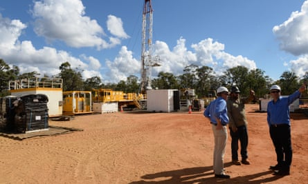 Santos staff at a coal seam gas well rig in the Pilliga forest at Narrabri, Australia