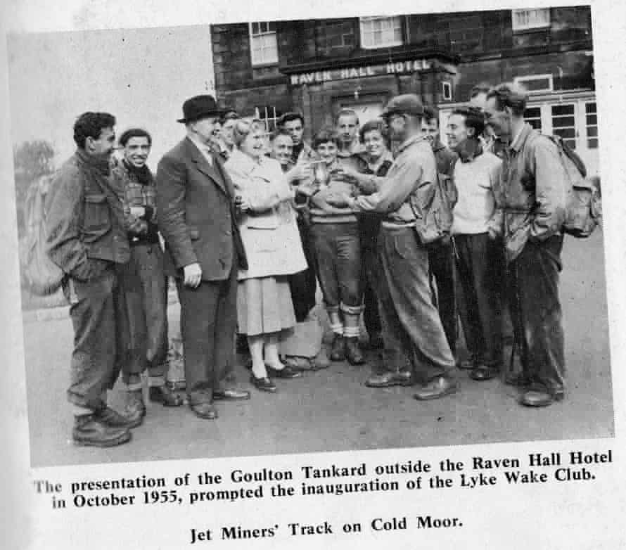 Bill Cowley (flat cap) being given a commemorative tankard in Ravenscar with the rest of the group who completed the first Lyke Wake Walk in October 1955.
